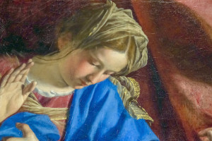 A detail of an old cracked painting of the Virgin Mary in the moment of the Annunciation