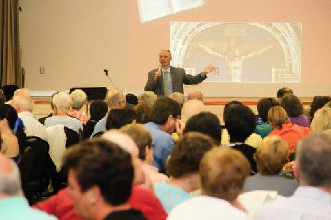 Matthew Leonard Speaking at an Event